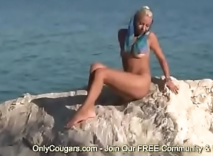 Petite Blonde Puts On A Striptease Outdoors
