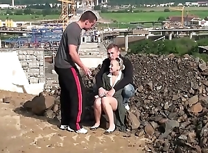 Young blonde little hottie is fucked in public dealings construction site threesome