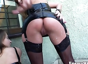 Latex lesbians drenched in milky anal squirt