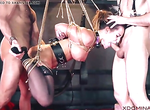 Brunette double permeated during fetish threesome