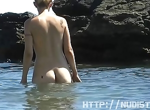 Saw this fit and firm Lady in front nudist beach